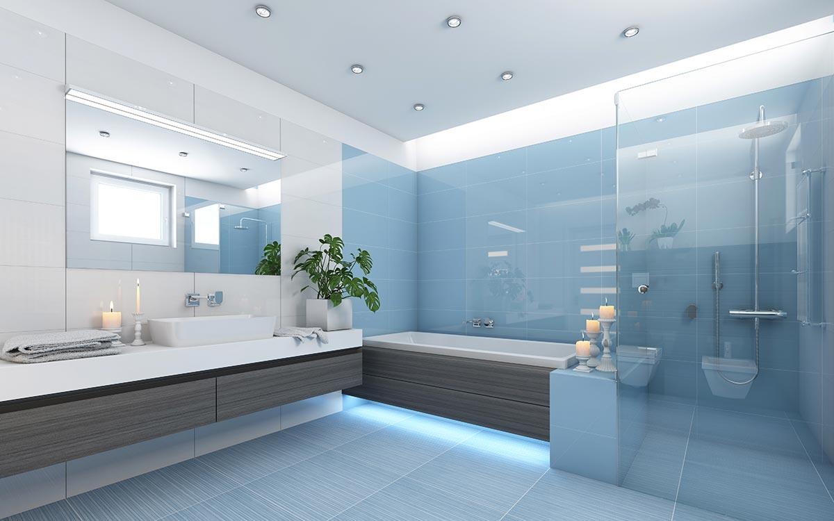 Bagno moderno con parete azzurra e box doccia trasparente.