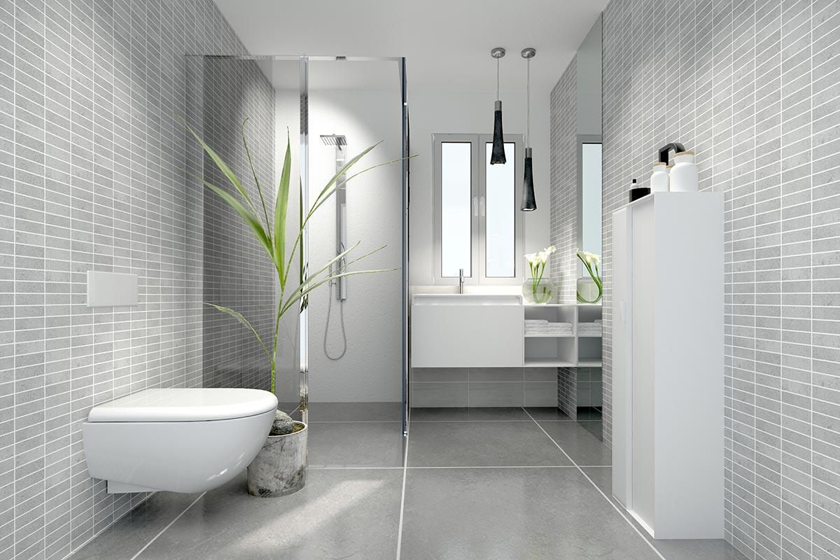 Bagno moderno con rivestimento murale effetto mosaico grigio chiaro e mobili bianchi.
