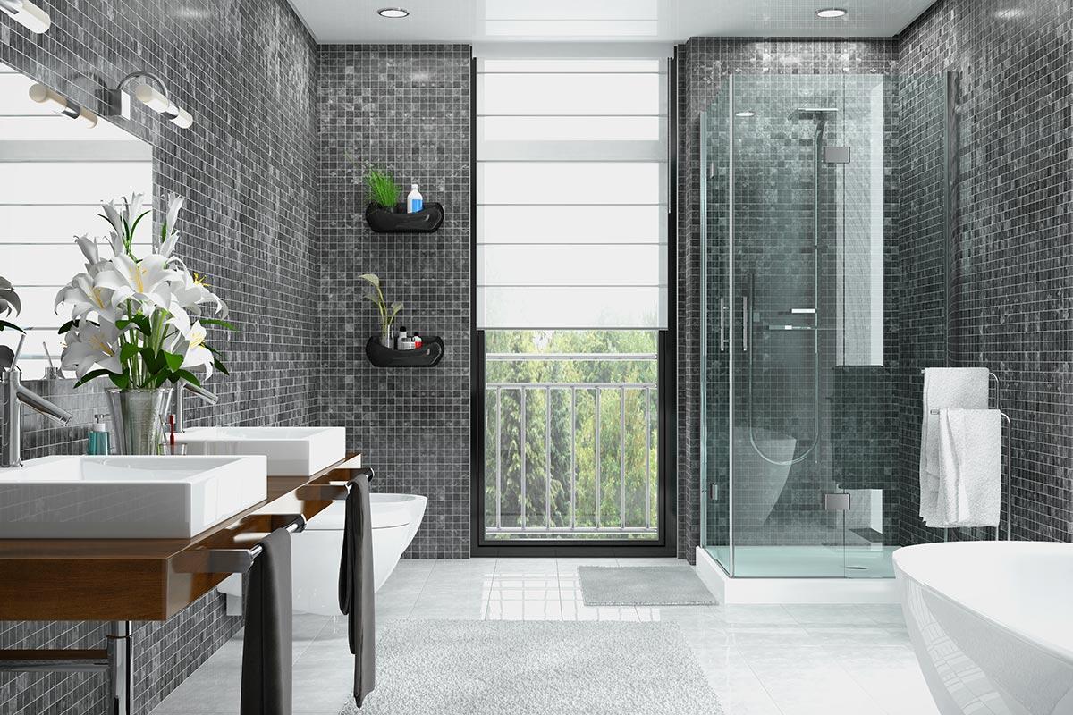 Bagni moderni con rivestimento piastrelle mosaico grigio antracite.