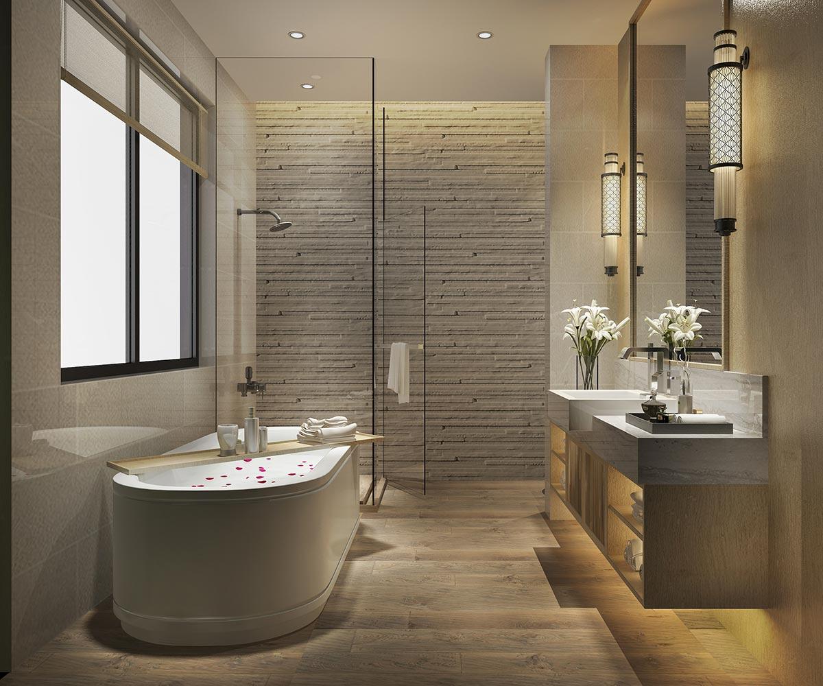 Bagno moderno con rivestimento in pietra e mobili sospesi con luci LED.