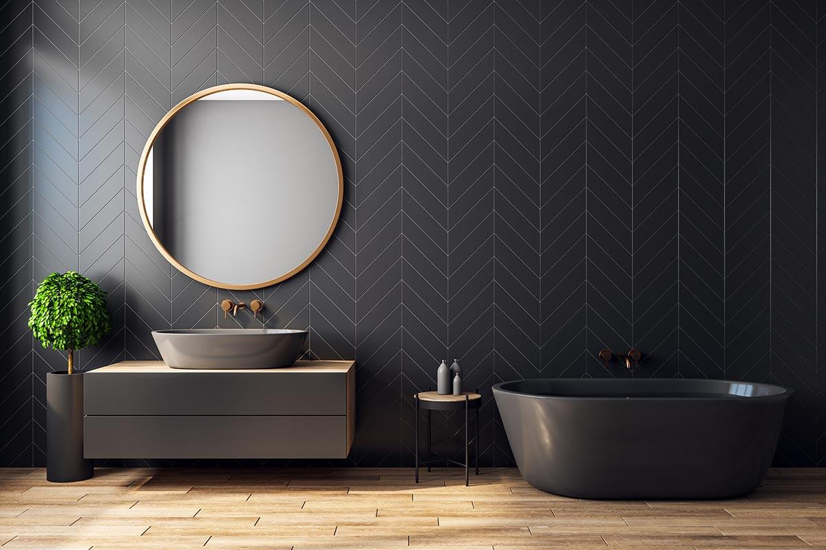 Rivestimento bagno moderno nero con motivi geometrici.
