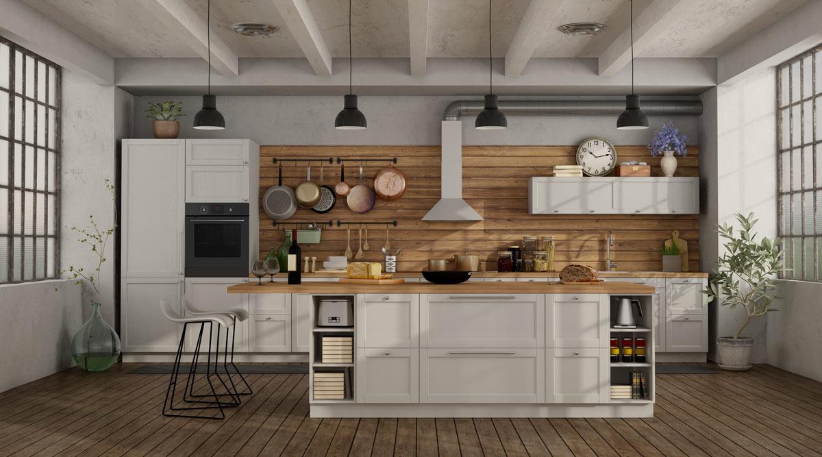 Cucina con isola centrale legno e bianco.