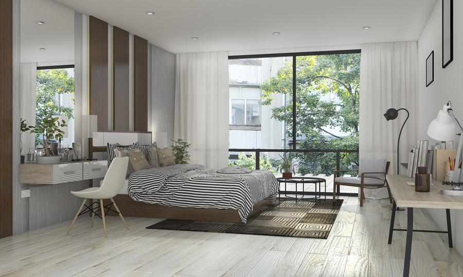 Camera da letto moderna con pavimento in parquet laminato grigio chiaro.